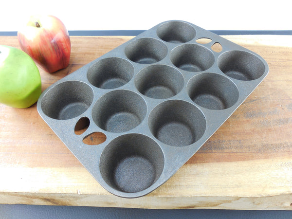 SOLD... Wagner Ware USA Cast Iron Pop Over Muffin Pan - 11 Cup Hole