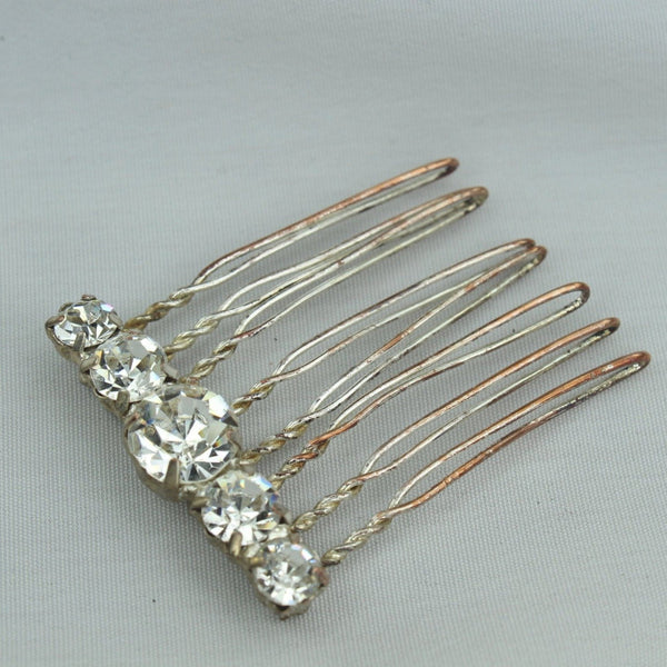 Neat Vintage Antique Hair Pin Decoration. Metal hair pin like base with large shiny Rhinestones. Metal shows vintage Stones great!  Fun piece.