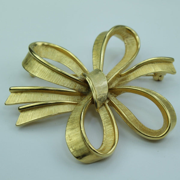 Vintage MONET Pin Gold Free Form Stylized Bow Mid Century