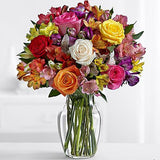 lilies, white roses, pink roses and yellow roses make up this beautiful bouquet