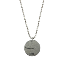 "Load image into Gallery viewer, ""KARMACOMA"" COIN NECKLACE - MASSIVE ATTACK X LEGACY OF WAR COLLABORATION"