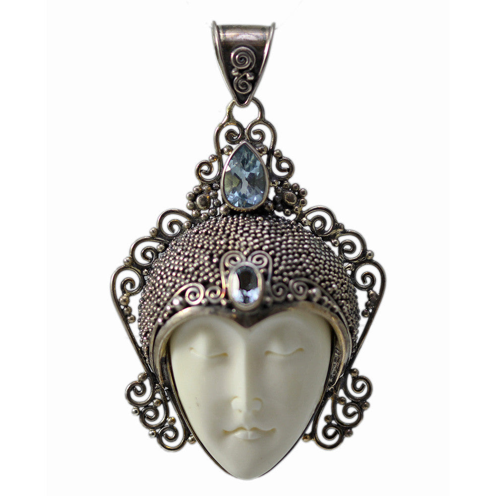 Large Carved Bone Face Pendant with Blue Topaz