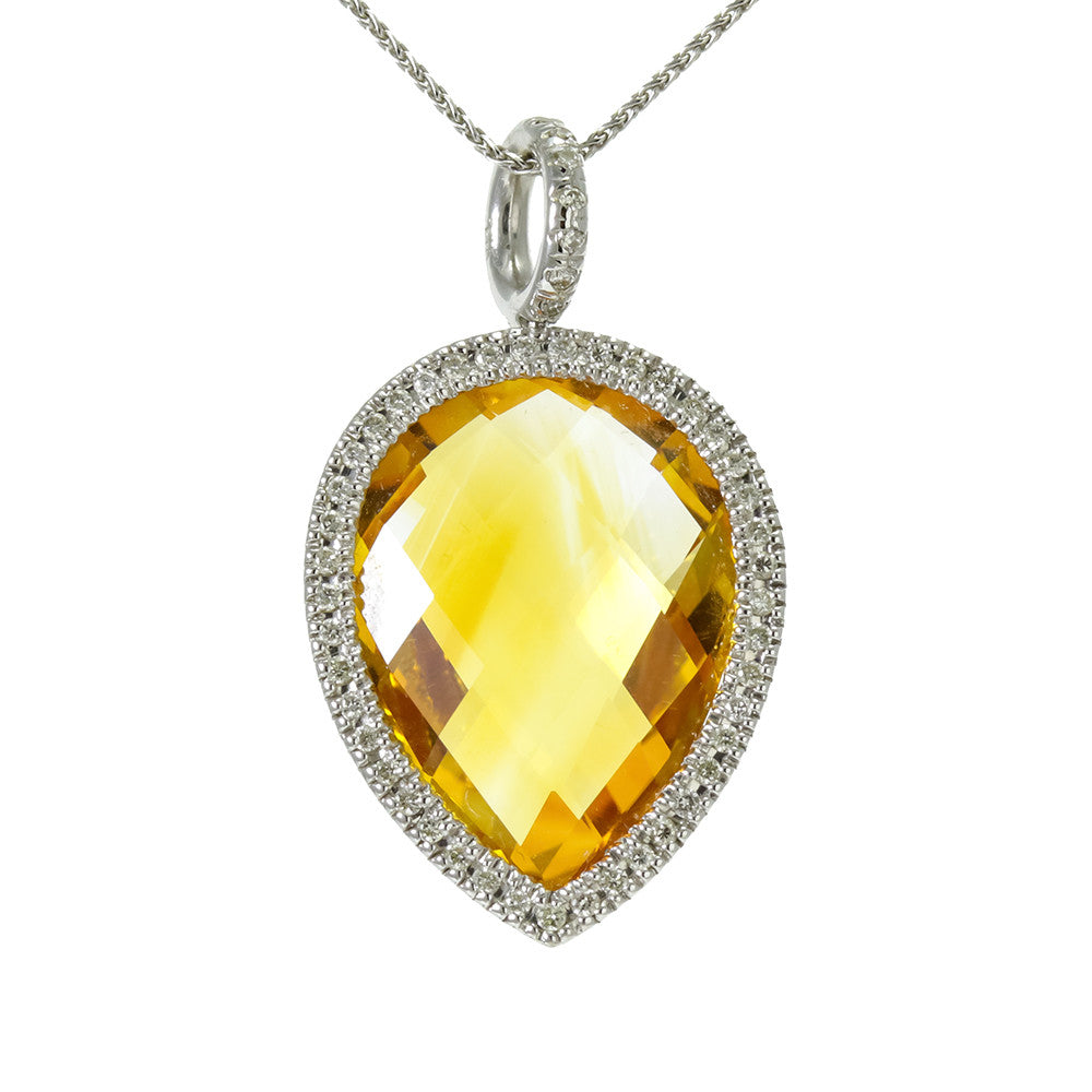 14k white gold reversible halo setting with pear shape citrine