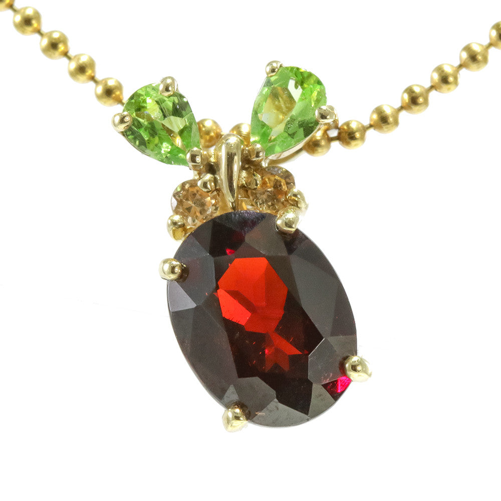 14k yellow gold beaded chain with oval garnet and two pear shaped peridot