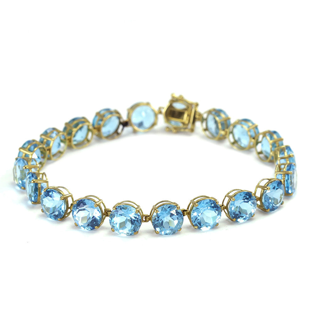 14k yellow gold round blue topaz tennis bracelet