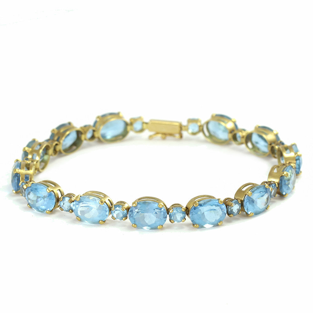 14k yellow gold oval and round blue topaz tennis bracelet
