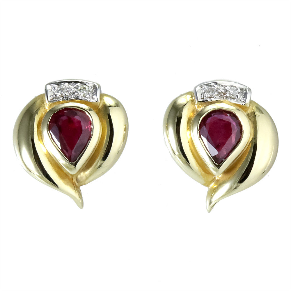 14k yellow gold pear shaped ruby and diamond stud earrings