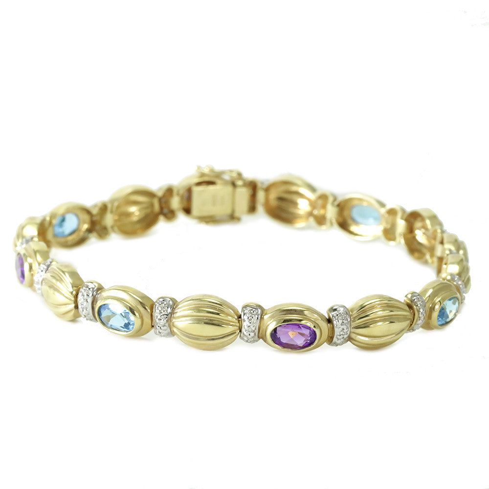 14k yellow gold blue topaz, amethyst and diamonds tennis bracelet