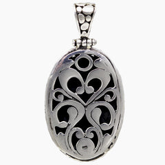 Oval Sterling Silver Pebbled Pendant with Decorative Back