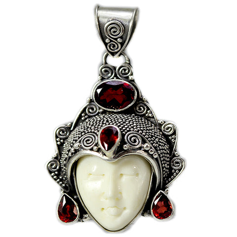 Carved Bone Face Pendant with Four Garnet Stones