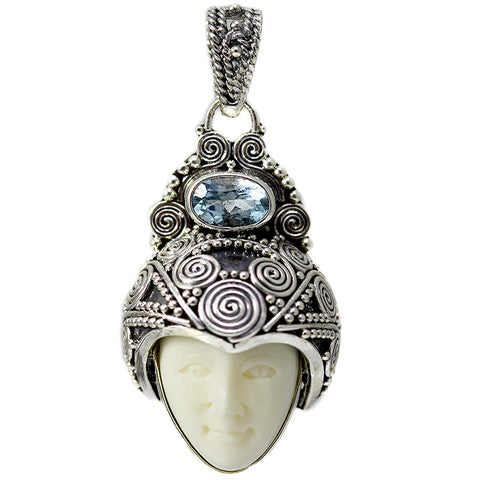 Carved Bone Face Pendant with Blue Topaz Stone