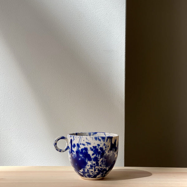 Blue and white splatter mug