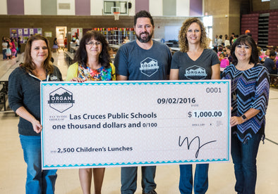 Organ Mountain Outfitters Presents A $1,000 Check to the Las Cruces Public Schools