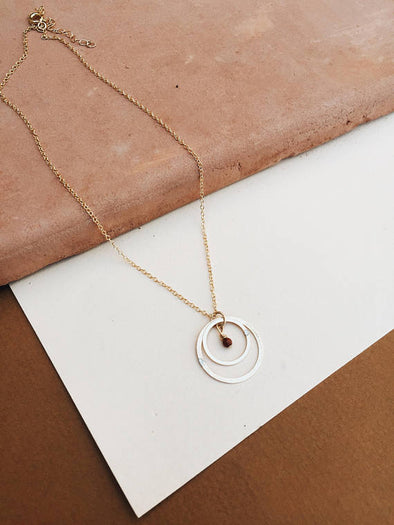 Tumble - Resolve Double Circle Necklace with Goldstone Accent