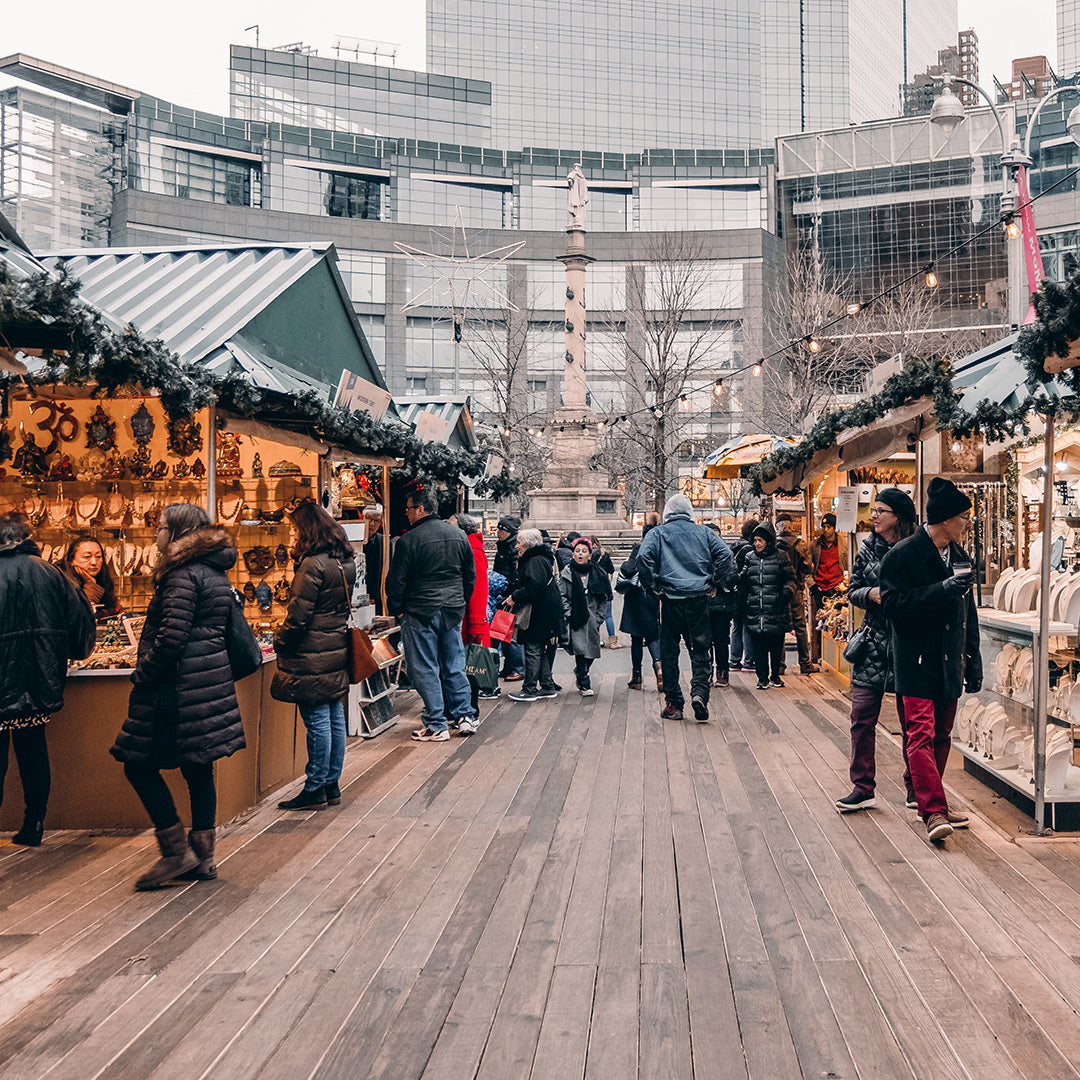 image of people Holiday shopping in the city in an outdoor market.