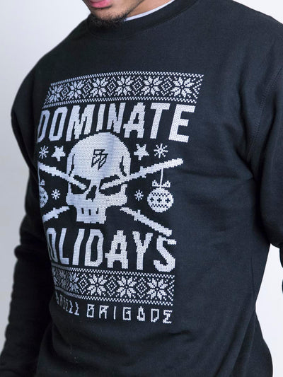 Dominate Holidays sweater from front closeup on logo.
