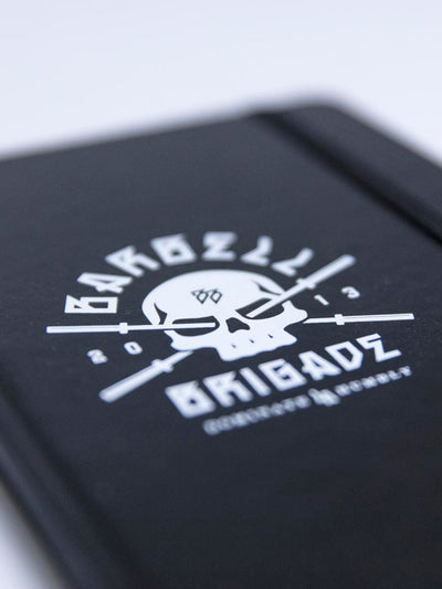 Closeup of logo on black notepad