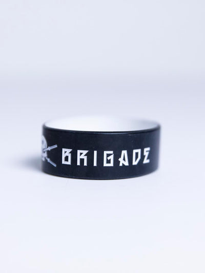 Black wristband with white Barbell Brigade logo