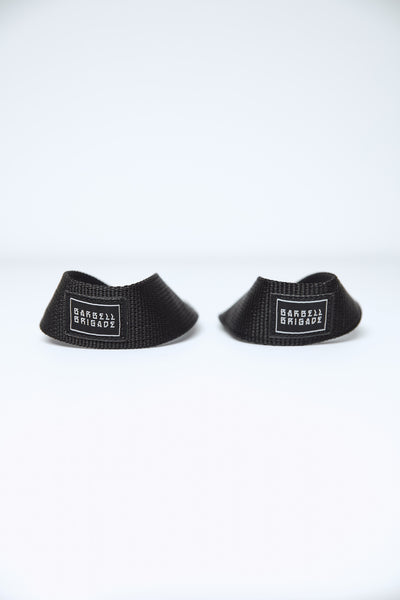 Two lifting straps with Barbell Brigade logo.