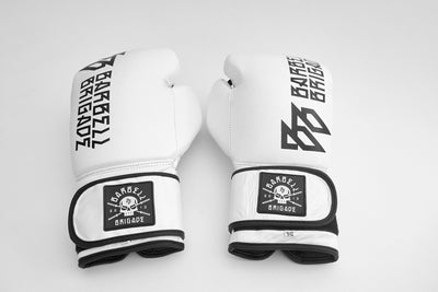 Two boxing gloves facing upwards with logo