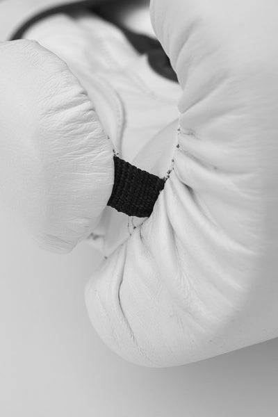 Closeup of thumb section and fingers section of boxing glove.