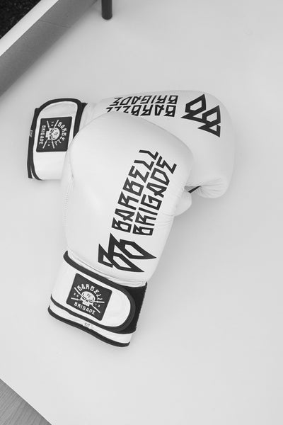 Top of white UVU boxing gloves laid on top of eachother.