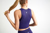 Lux Scoop Neck Crop Tank in purple from back.
