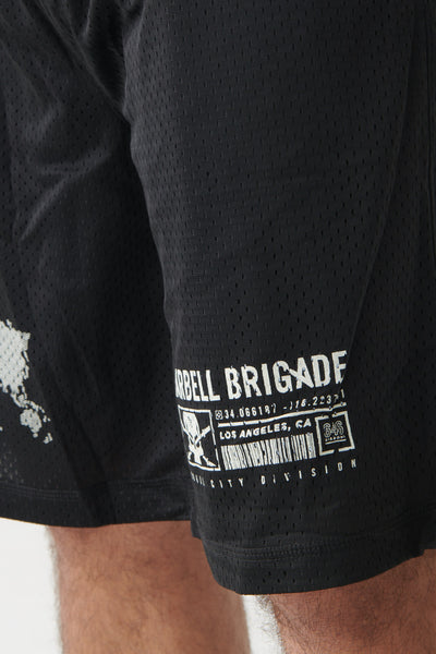 Coordinate Mesh Shorts in black logo closeup.