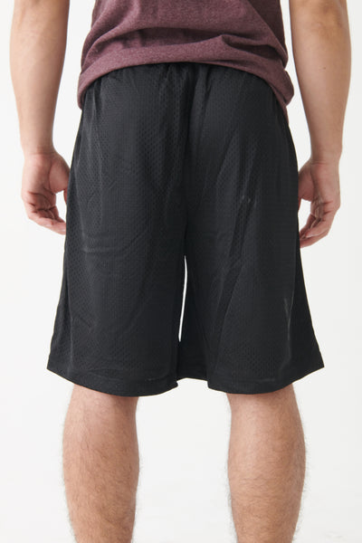 Coordinate Mesh Shorts in black from backside.