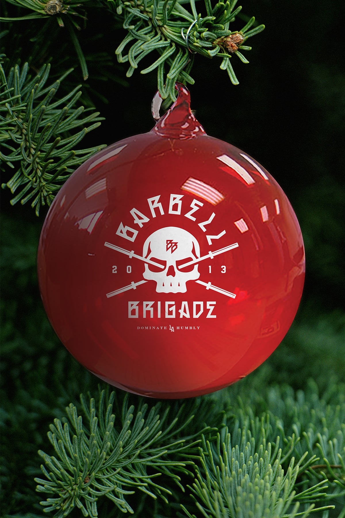 Red glass ornament with Barbell Brigade logo