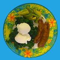 eggs, avocado, and sausages on a plate