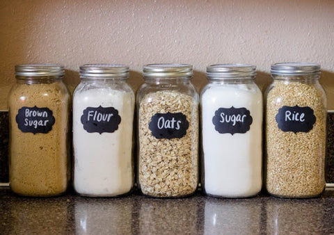 jars of brown sugar, flour, oats, sugar, and rice