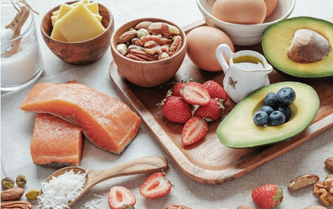 healthy fats sources: avocado, salmon, strawberries, nuts