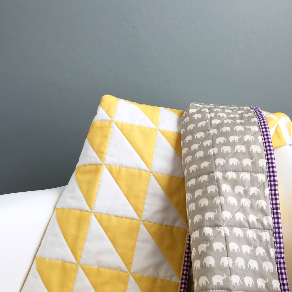 yellow-and-white whole-cloth baby quilt for a friend