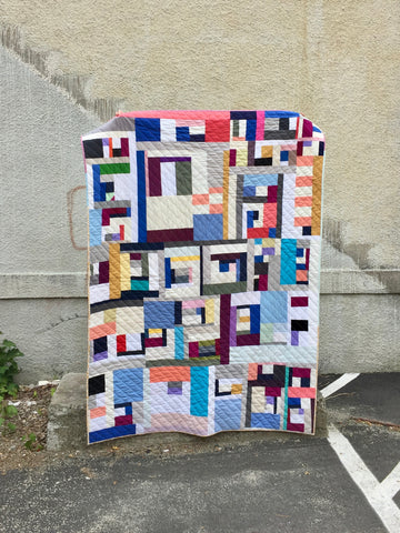 solid improv throw quilt by salty oat