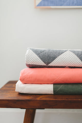 Stack of Folded Quilts by Salty Oat