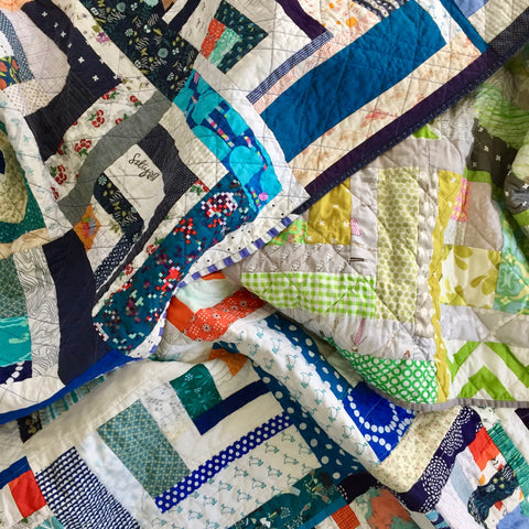 pile of quilts by the modern quilt collective
