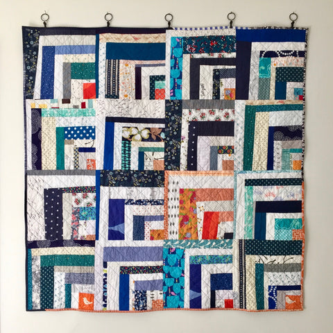 quarter log cabin quilt by the modern quilt collective