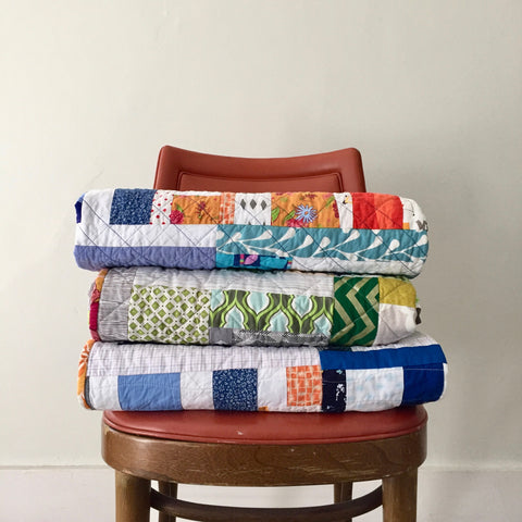 stack of quilts by the modern quilt collective