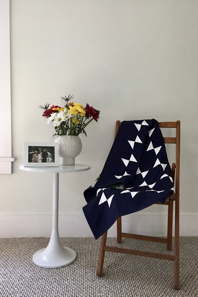 Navy-and-White Amish Hourglass Baby Quilt