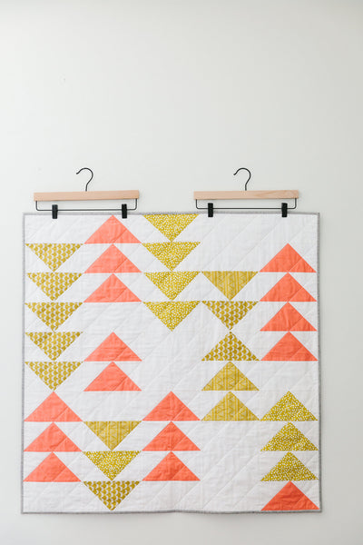 Pink-and-Yellow Flying Geese Baby Quilt
