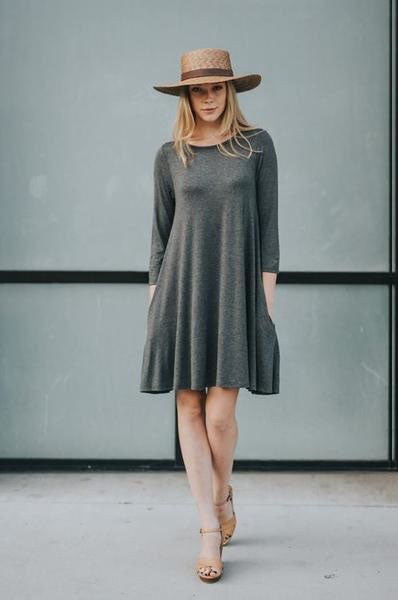 A line tunic dress with hidden pocket. 3/4 sleeve