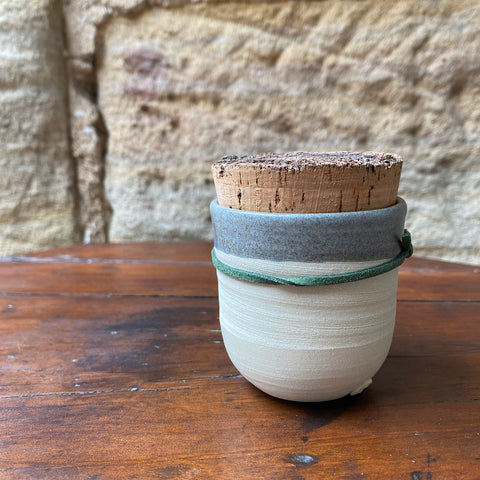 Candle in ceramic pot