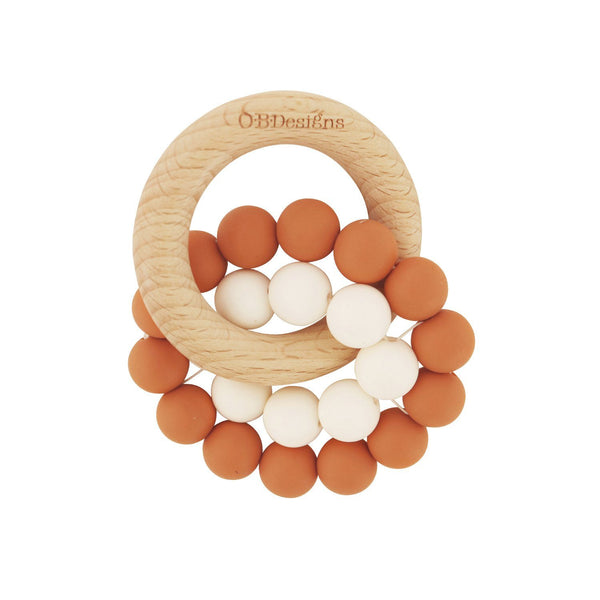 Eco-Friendly Teether Toy for babies made from Organic and responsibly sourced Beechwood and Silicone. Eco-friendly teethers made by OB Designs Australia all ethical and helps sooth teething pain. Cinnamon Colour ring, small white ring, with beachwood ring.