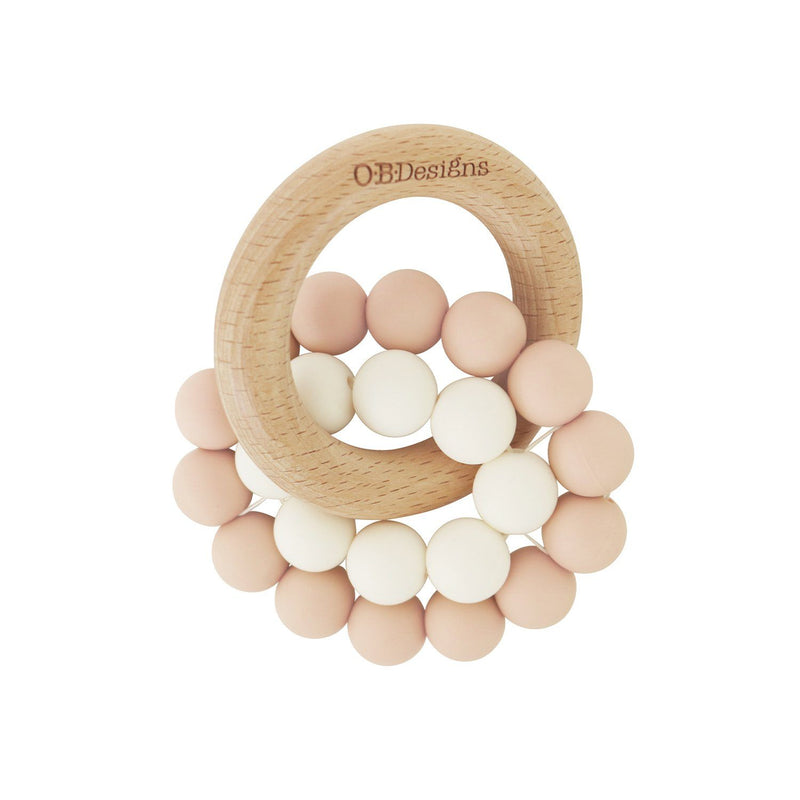 Eco-Friendly Teether Toy for babies made from Organic and responsibly sourced Beechwood and Silicone. Eco-friendly teethers made by OB Designs Australia all ethical and helps sooth teething pain. Blush Colour ring, small white ring, with beachwood ring.