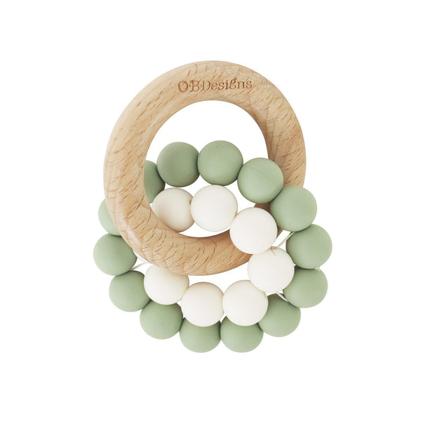Eco-Friendly Teether Toy for babies made from Organic and responsibly sourced Beechwood and Silicone. Eco-friendly teethers made by OB Designs Australia all ethical and helps sooth teething pain. Sage Colour ring, small white ring, with beachwood ring.