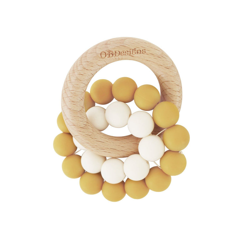 Eco-Friendly Teether Toy for babies made from Organic and responsibly sourced Beechwood and Silicone. Eco-friendly teethers made by OB Designs Australia all ethical and helps sooth teething pain. Turmeric Colour ring, small white ring, with beachwood ring.
