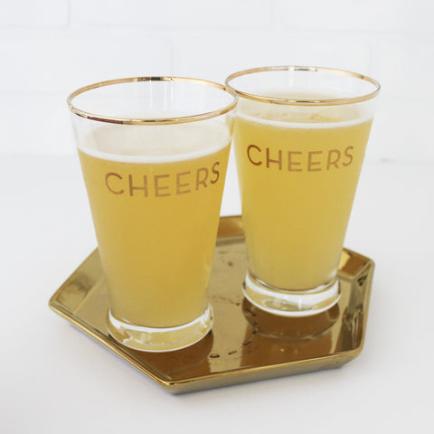 Pub Glass with 'Cheers' in gold and gold rim, on gold hexagonal platter
