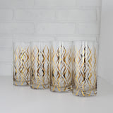 Four Highball Glasses with Gold Print