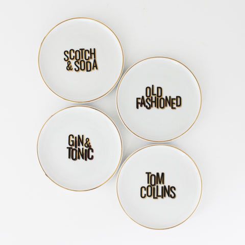 Coasters/Cocktail Plates, set of 4; 'Gin & Tonic,' 'Scotch & Soda,' 'Tom Collins,' 'Old Fashioned,' black and gold lettering